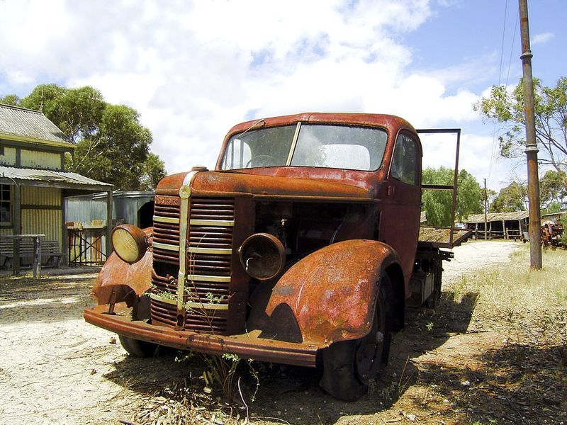 A wrecked truck rusting in a deserted country town Forgotten Abandoned Bad Condition Damaged Day Field Land Vehicle Mode Of Transport No People Obsolete Outdoors Run-down Rusty Sky Transportation Tree Wrecked Truck