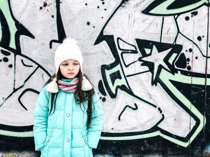 Cute snowgirl Graffiti Ice Blue Teenager Cute Front View Childhood Graffiti Child One Person Standing Portrait Real People Lifestyles Girls Looking At Camera Wall - Building Feature Day Winter Warm Clothing This Is Natural Beauty