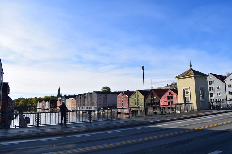 """Snap on another photographer, Bridge over Nidelva, Trondheim, Norway. Nidelva is a river in Trøndelag county, Norway. The 30-kilometre long river travels through the municipalities of Trondheim and Klæbu. The name translates to the """"River Nid"""" since the suffix elva or elven is the Norwegian word for """"river"""". Photographer Another Photographer Bridge Nidelva Trondheim River Riverview On A Bridge Trondheim City Center Mydtbyen Architecture City Tower Travel Destinations"""