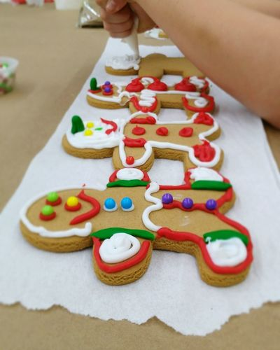 Close-up of child decorating gingerbread
