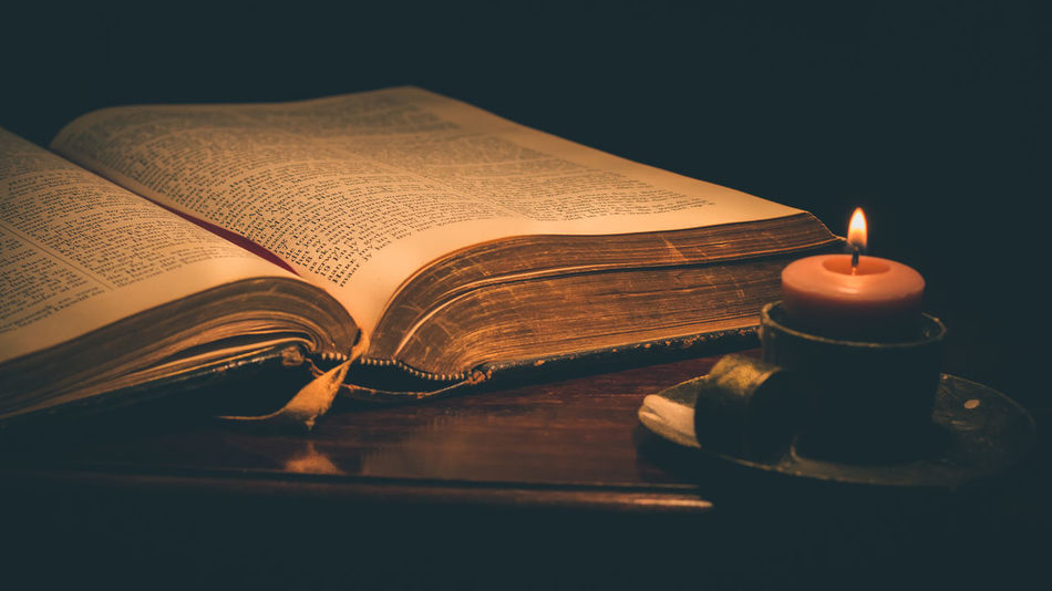 Bible Book Candle Candle Candlelight Close-up Dark Flame Indoors  Literature Night No People Open Page Relegion Relegious Spirituality Table Wisdom
