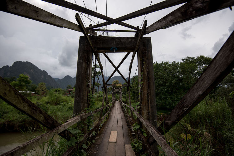 Tree Transportation Sky Connection Bridge Plant Nature Bridge - Man Made Structure Direction Wood - Material Built Structure The Way Forward Architecture No People Day Diminishing Perspective Land Metal Outdoors Railway Bridge Laos ASIA