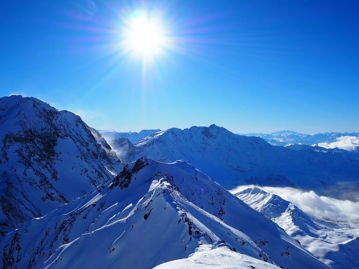 Kaiserwetter in the French alpes Cold Temperature Winter Sky Mountain Snow Sunlight Beauty In Nature Scenics - Nature Sun Blue Snowcapped Mountain Mountain Range Tranquil Scene Sunbeam Lens Flare Tranquility Non-urban Scene Environment Sunny Bright No People Mountain Peak
