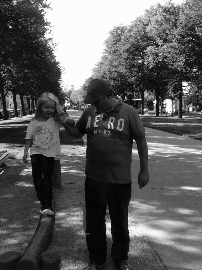 Fatherhood Moments Father And Daughter love my little girl walk together Tree Full Length Leisure Activity Lifestyles Casual Clothing Park - Man Made Space Person Togetherness Standing Street Footpath Friendship Day Outdoors Growth (null)City Life A Little Help