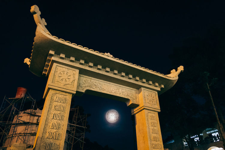 Moon rise through the gate Moon Moonlight Gate Pagoda Temple Worship Worship Place Vietnam Saigon Lunar Buddhism Buddha Architecture Night Travel Destinations History Built Structure Tourism City Sky Building Exterior Sculpture