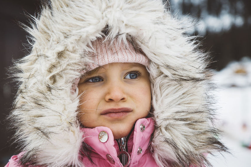 Portrait of little girl dressed in winter clothes with furry hood. Child Childhood Children Close-up Cold Temperature Cute Fur Fur Coat Fur Hat Girl Headshot Hood Knit Hat Lifestyles One Person Outdoors People Portrait Real People Snow Warm Clothing Wearing Winter