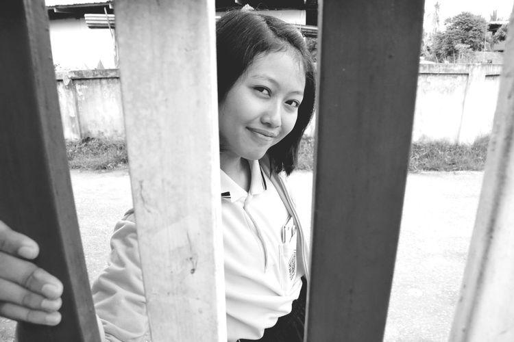 Portrait Of Girl Seen Through Fence
