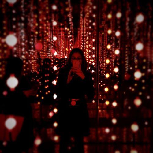 Woman using phone at night