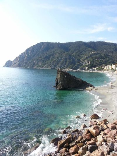 Sea Water Nature Beauty In Nature Sky Mountain Tranquility Sand Vacations Wave Beach Monterosso Al Mare Liguria,Italy Outdoors Scenics Rock - Object No People Blue Day Horizon Over Water