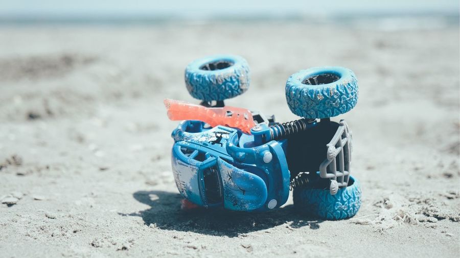 Close-up of toys on beach