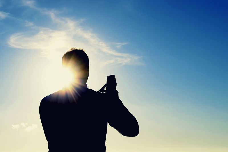 Sesión timelapse Silhouette One Man Only Only Men One Person Adults Only Adult Back Lit Lens Flare Sunlight Sky Men People Photographing Outdoors Sun Wireless Technology Day Standing Low Angle View One Young Man Only