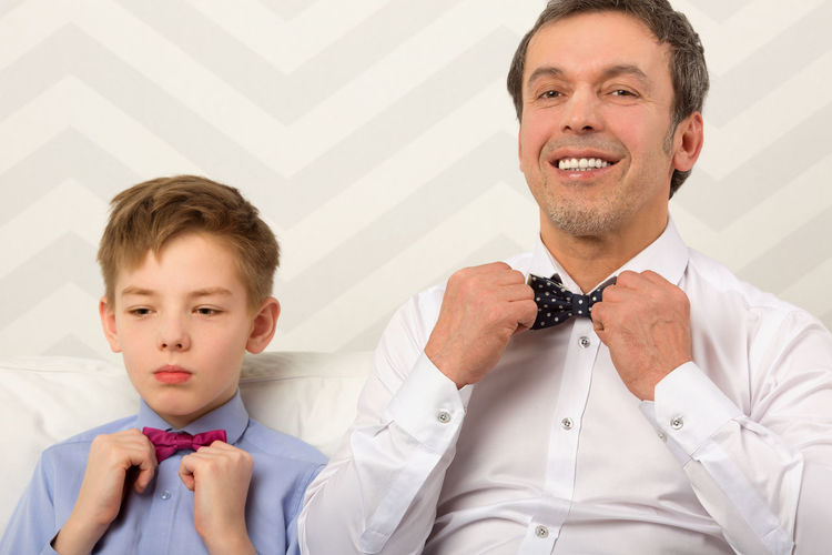 Adjust Bow Tie Bowtie Caucasian Celebrate Ceremony Child Childhood Clothes Clothing Dad Daddy Daughter Family Father Fatherhood  Formal Horizontal Kid Man Parent Teenager
