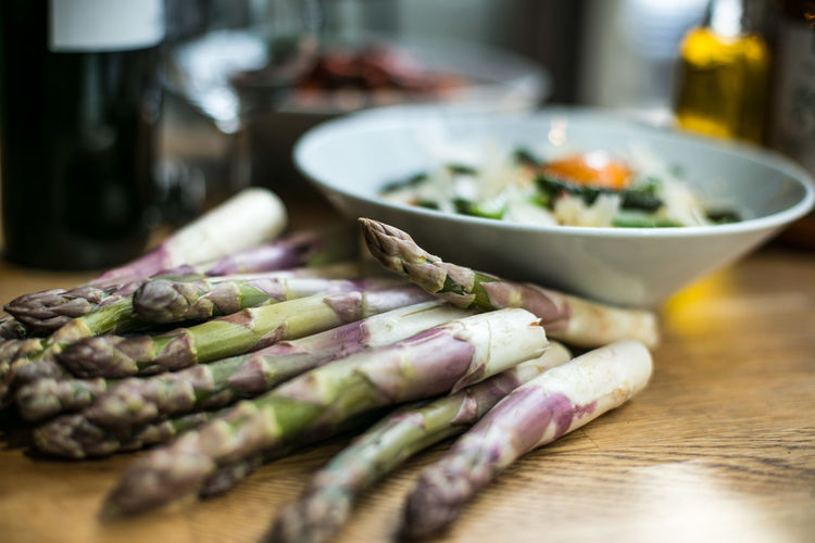 Close-up of asparagus on table