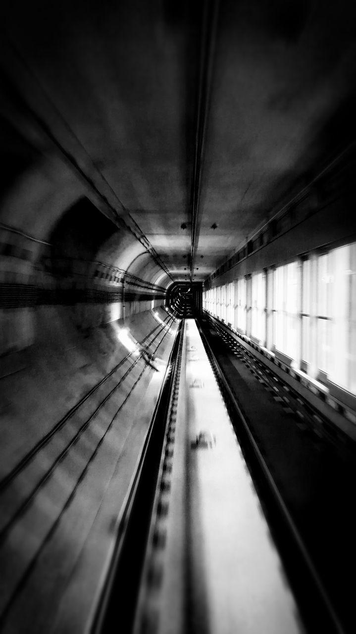 CLOSE-UP OF ESCALATOR IN UNDERGROUND WALKWAY