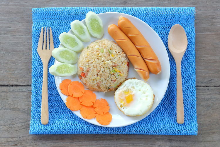 American Fried Rice American Fried Rice Cucumber Fried Egg Side Dish Wood Day Eat Egg Food High Angle View Napery Plate Ready-to-eat Sausage Sidedish Table Wood Top View Top View Of Food Topview Vegetable Wood - Material