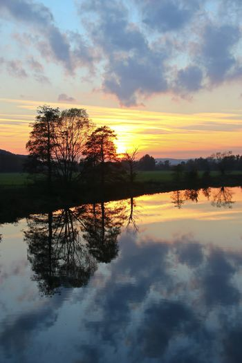 Sundown reflections Ruhr  Beauty In Nature Cloud - Sky Nature No People Non-urban Scene Orange Color Outdoors Plant Reflection Reflection River River Scenics - Nature Silhouette Sky Symmetry Tranquil Scene Tranquility Tree Water Waterfront