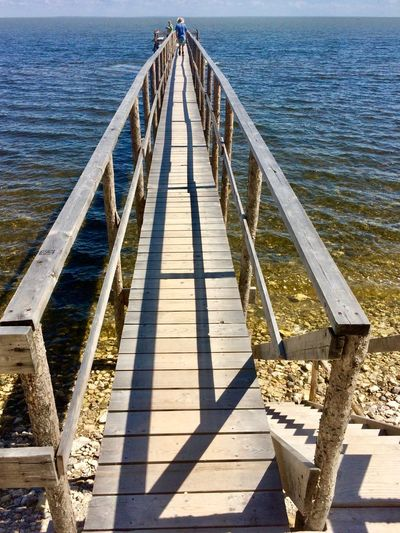 Lake Winnipeg Manitoba, Canada Boardwalk Built Structure Diminishing Perspective Direction Long Man Walking Pole Pier Railing The Way Forward Walkway