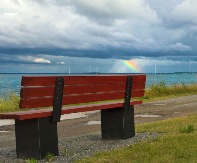 Small sea side town called Repossari in western Finland Cloud - Sky Sea No People Horizon Over Water Water Outdoors Day Nature Scenics Sky Multi Colored Rainbow🌈 Repossari Finland Windmills Bench Coastline Clouds EyeEmNewHere Eyeemphotography