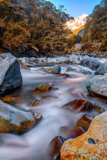 Rapid flowing river set amidst mountain valley with snow capped background Awe Beauty In Nature Day Forest Lake Landscape Nature No People Outdoors Scenics Sunset Tranquil Scene Tranquility Tree Water Winter