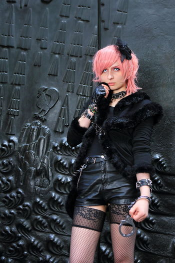 cosplay girl dressed up in leather hot pants and gloves with pink hair for Japan Day in Düsseldorf Anime Animegirl Black Düsseldorf Eyes Girls Rule Handcuffs  Headpiece Hot Hot Pants Japan Day Japantag Japantag Düsseldorf KAWAII Leather Manga Pink Hair Playtime Portal Sexygirl Stockings