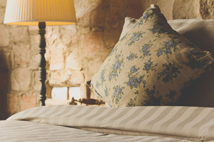 Pillows on an antique luxury bed Bed Classic Style Luxury Hotel Antique Furniture Bed Bedroom Close-up Day Indoors  Luxury No People Pillow Pillows