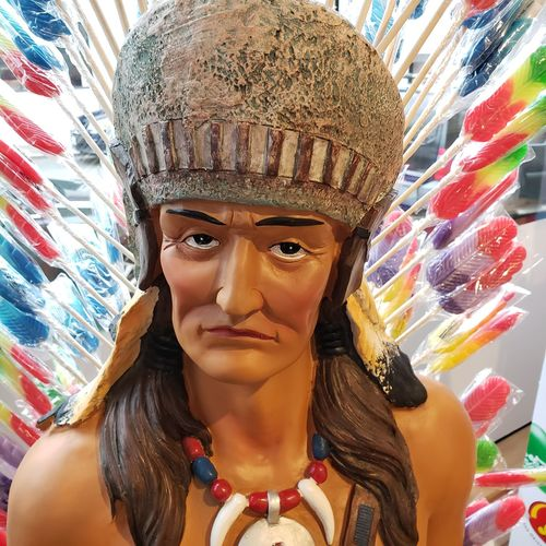 The Candy Man... Candy Indian The Mobile Photographer - 2019 EyeEm Awards Portrait Headshot Young Women Front View Looking At Camera Close-up Headdress North American Tribal Culture Lollipop Candy Store Sweet