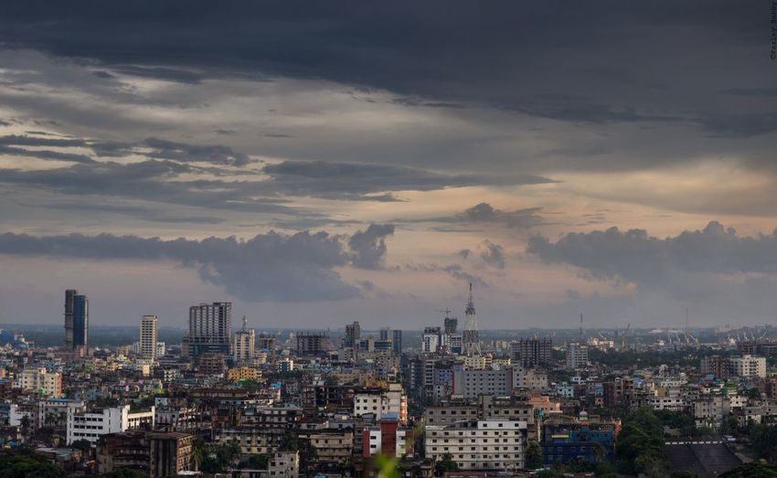 High Angle View Of Cityscape Against Cloudy Sky During Sunset