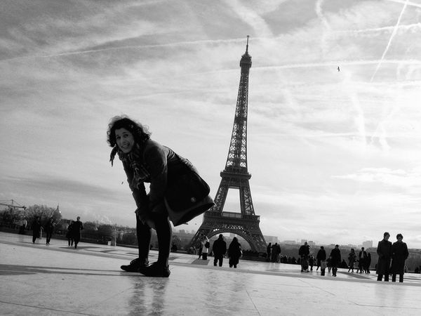 Woman kicking Eiffel tower with her back Adult Adults Only Army City Cultures Day Eiffel Tower Fame Fun Funny History Only Women Outdoors Paris People Real People Sky Warrior - Person Woman Young Adult Blackandwhite Black And White Black & White Portrait Of A Woman Portrait