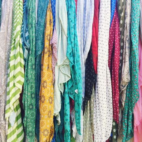 Full Frame Shot Of Colorful Clothes Hanging In Market For Sale