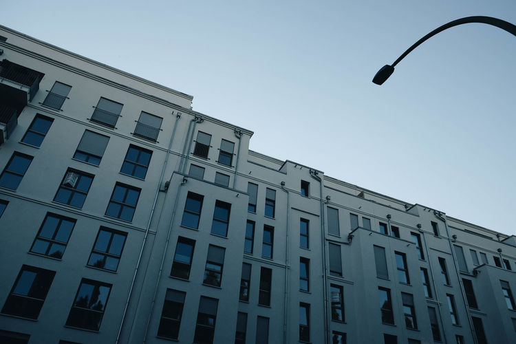 Architecture Blue Building Building Exterior Built Structure City Clear Sky Day In A Row Lighting Equipment Low Angle View Nature No People Outdoors Residential District Sky Street Street Light Sunlight Window