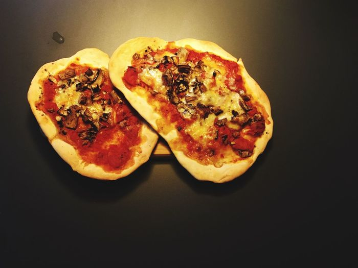 Close-up of pizza against black background