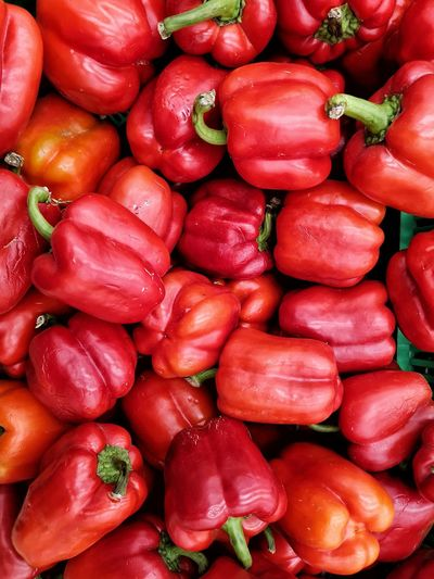 Full frame shot of red bell peppers at market stall