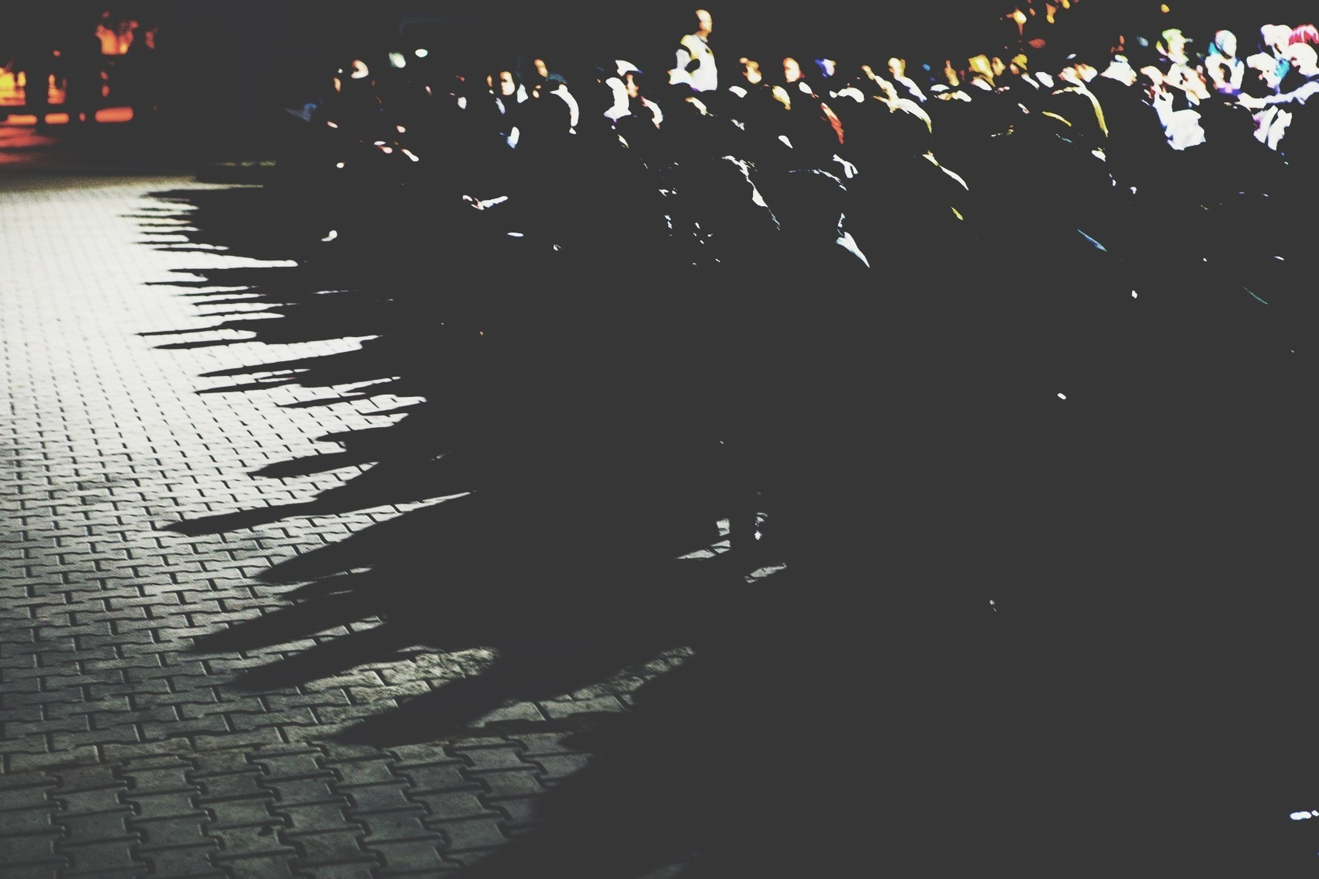 night, illuminated, large group of people, city, dark, street, lighting equipment, building exterior, outdoors, silhouette, built structure, light - natural phenomenon, city life, in a row, celebration, architecture, incidental people, men, light