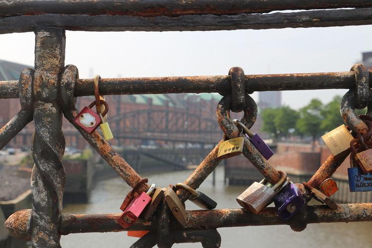 Close-up of padlocks on metal fence