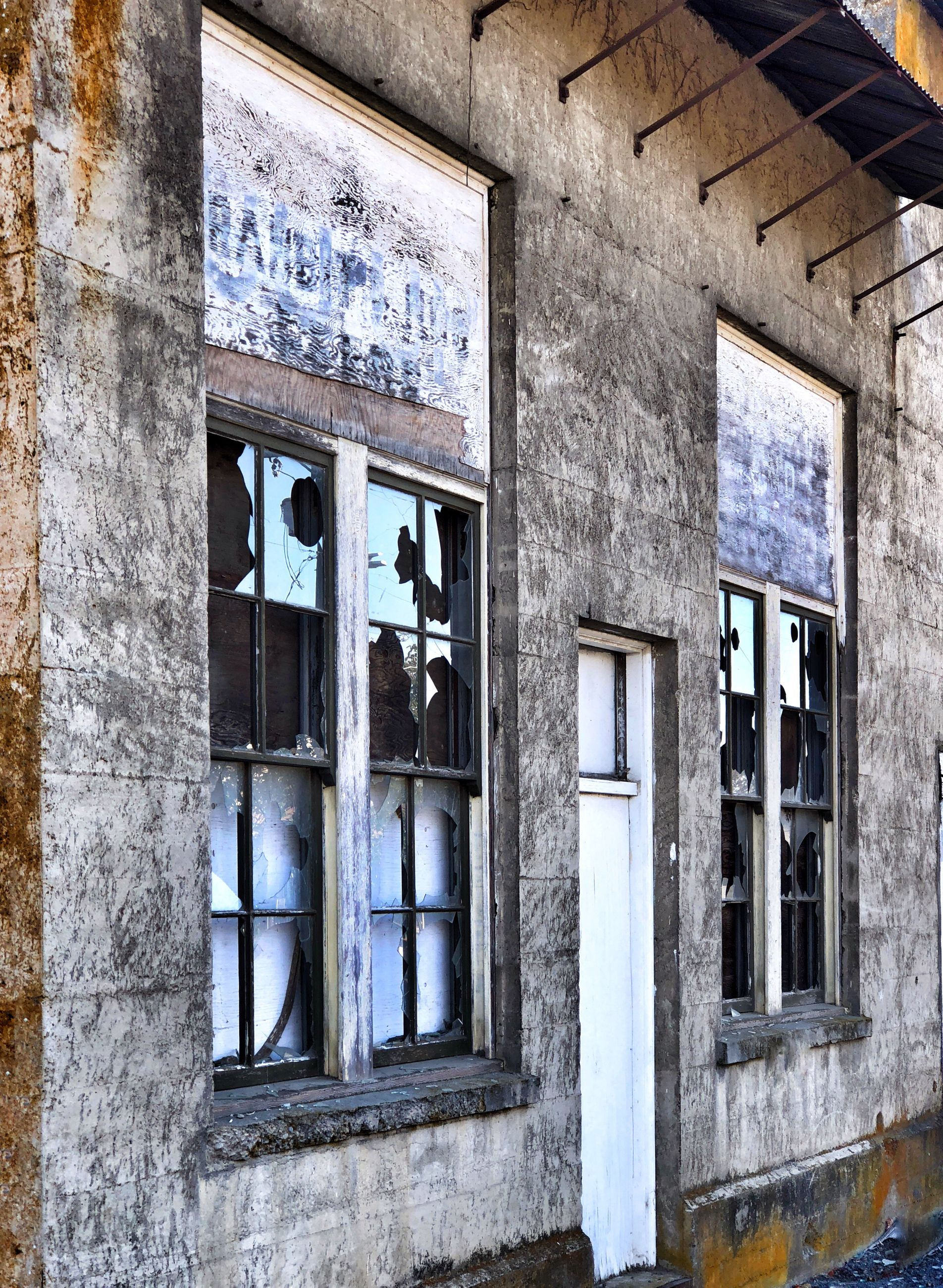 window, architecture, built structure, building, building exterior, no people, day, old, glass - material, abandoned, reflection, wall, outdoors, low angle view, house, residential district, damaged, weathered, wall - building feature, bad condition, ruined