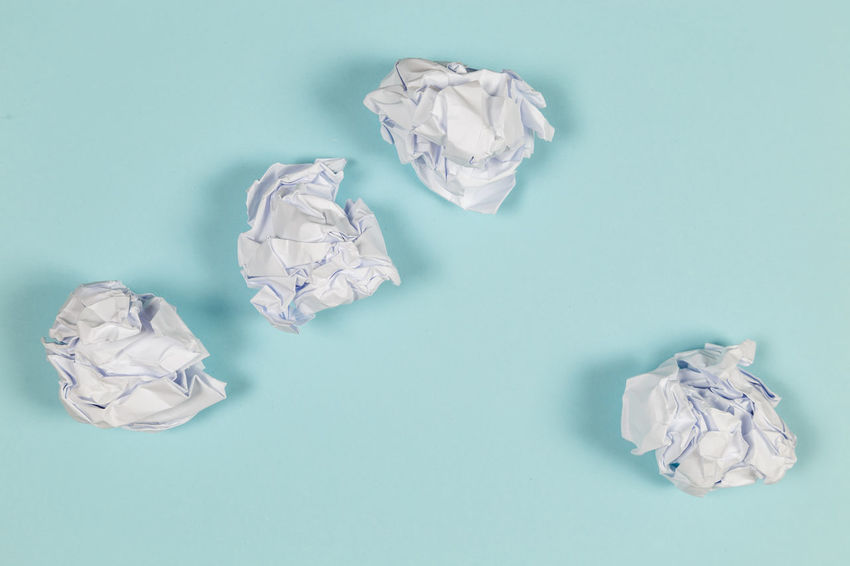 Crumpled Crumpled Paper Crumpled Paper Ball Studio Shot Indoors  Paper No People Garbage High Angle View Negative Emotion Copy Space Frustration Still Life Colored Background Blue Background Emotion Large Group Of Objects Garbage Bin Blue