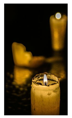 Candle Burning Flame Gold Colored Heat - Temperature Yellow Indoors  Close-up No People Illuminated Black Background