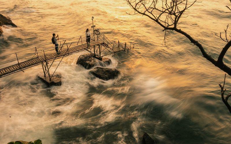 High angle view of couple at sunset, sai wan swimming shed, hong kong