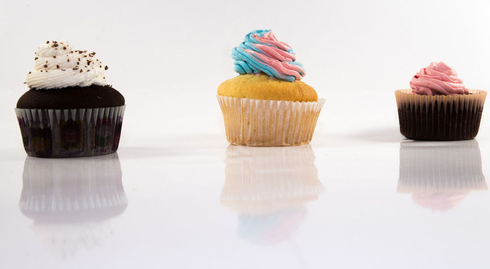 Flavoured Cupcakes Cake Close-up Cupcake Day Dessert Food Food And Drink Freshness Frosting Indoors  Indulgence Muffin No People Product Product Photography Ready-to-eat Reflection Sprinkles Studio Shot Sweet Food Temptation Unhealthy Eating White Background