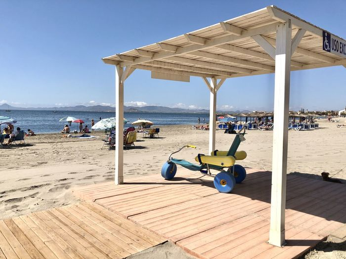 View of lounge chairs on beach