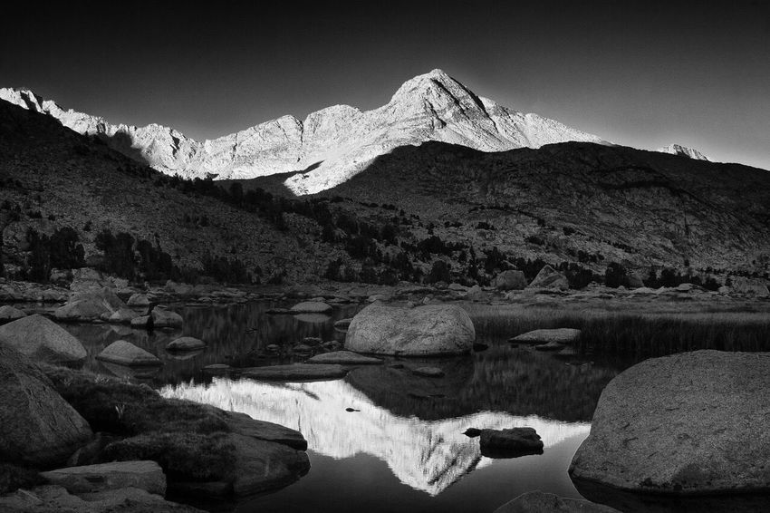 Sierra Reflection taken a few years back from an unnamed lake near Piute Pass in the Inyonationalforest just out of Bishop, CA Sierra Nevada Mountains Lake Landscape Blackandwhite Black And White California Eastern Sierra Sunrise Calm Serene Quiet Solitude Contrast Still