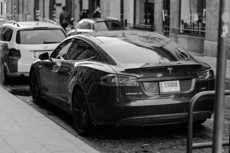 Architecture Blackandwhite Bnw Car City Day Land Vehicle Mode Of Transport No People Outdoors Stationary Tesla Transportation