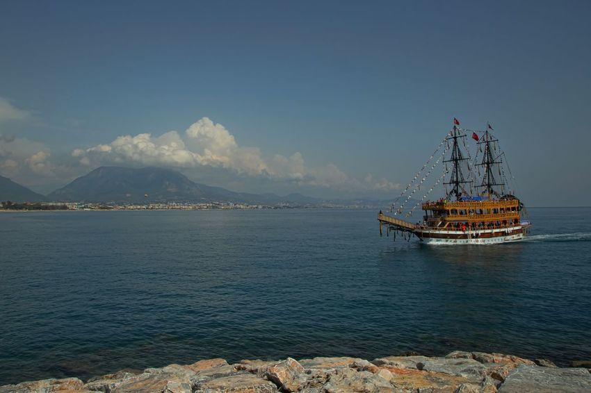 Pirate Ship Alanya/Turkey Mediterranean Sea Turkey Architecture Bay Beauty In Nature Built Structure Cloud - Sky Day Mode Of Transportation Mountain Nature Nautical Vessel Outdoors Passenger Craft Pirate Ship Sailboat Scenics - Nature Sea Ship Sky Transportation Travel Water Waterfront