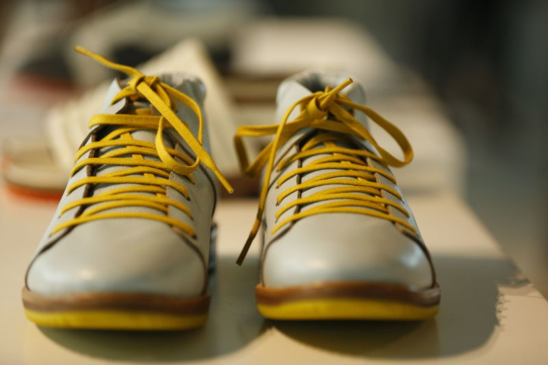 men's grey leather shoes with yellow shoe laces Ready To Wear Shoes Men's Shoes Leather Leather Shoes Grey Shoes Men Style Street Style Shoe Laces Yellow Shoe Laces Boy Shoes Indoors  No People Pair Close-up Yellow Day