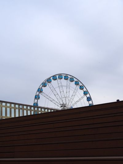 Taken on March, 28th 2019. Sky Amusement Park Amusement Park Ride Built Structure Architecture Ferris Wheel Low Angle View Arts Culture And Entertainment No People Building Exterior Nature Cloud - Sky Outdoors Day Building Travel Destinations Shape Railing Dusk Circle Geometric Shape Geometry Geometric Blue Copy Space Allas Sea Pool Fence Stairs Meeting Point Crossing Lines