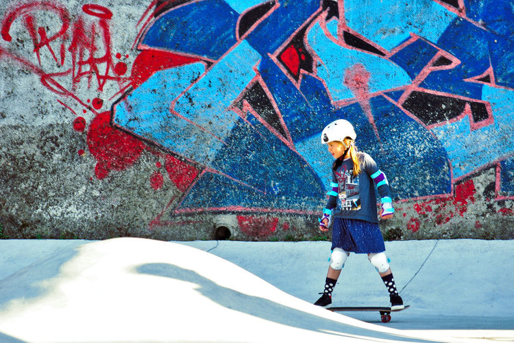 Skateboarding Skatepark Skill  Blue Casual Clothing City Creativity Day Full Length Girl Graffiti Hair Hairstyle Leisure Activity One Person Portrait Real People Skategirl Sport Standing Wall - Building Feature Summer Sports