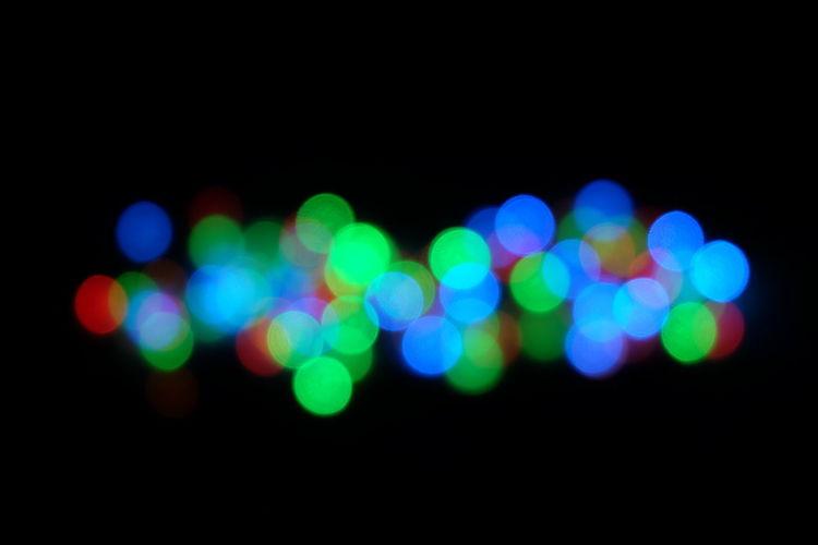 Defocused image of illuminated light bulb