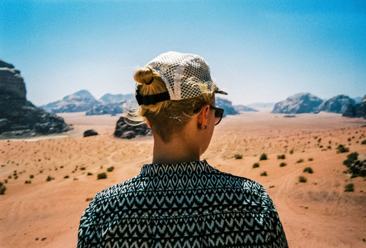 Analogue Photography Beauty In Nature Blue Cap Casual Clothing Clear Sky Day Desert Headshot Leisure Activity Lifestyles Mountain Nature Non-urban Scene Outdoors Person Scenics Sky Summer Sunlight Sunny Tourism Traveling Vacations Wadi Rum