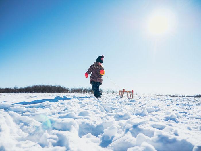 Full length of man on snow field against sky