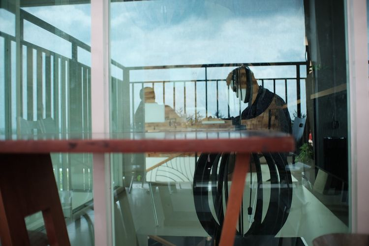 Reflection of woman on glass window